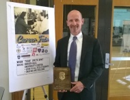 Acting U.S. Attorney, Bob Troyer, holds a Colorado Fair Chance Plaque at the recent October 27 | Colorado Springs Fair Chance Symposium at which he presented.